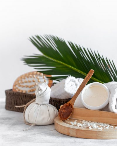 Spa composition with body care items on a light background . A place for text, a concept of beauty and body care .